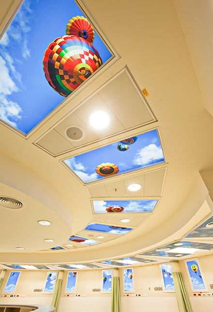 Cheerful balloon SkyCeilings and Luminous Virtual Windows brighten the emergency wing of Western Galilee Hospital.
